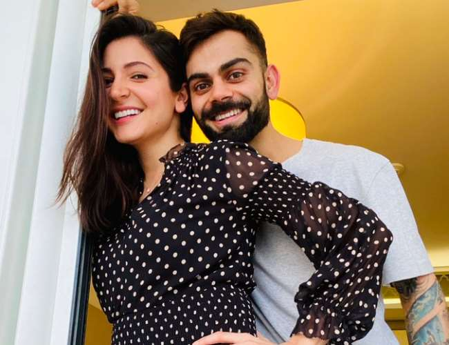Virat Kohli helping mom-to-be Anushka Sharma in pregnancy yoga sessions will warm the cockles of your heart | See Pics