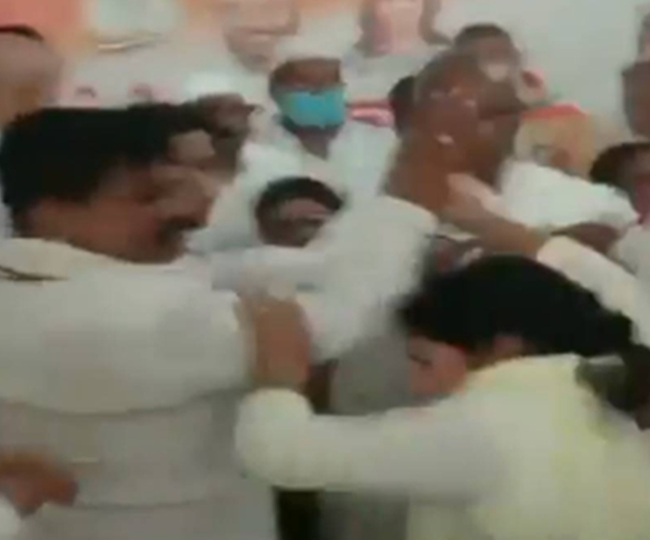 Caught on Camera: Congress Woman leader attacked by partymen after she questions move to field rape-accused in UP bypolls