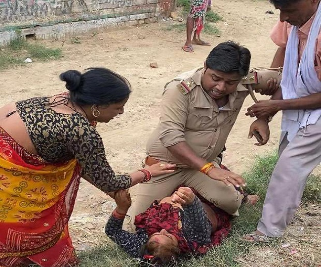 Cop allegedly beats, sits on top of woman in Kanpur Dehat; UP Police denies charge, orders probe