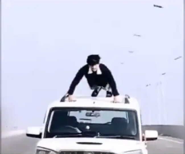 Man does push-ups on rooftop of moving car, UP Police 'rewards' him in THIS way | Watch video